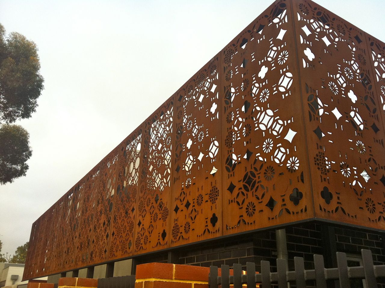 Laser cut facade panels for building exterior