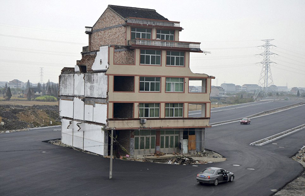 house in middle of road luo baogen Road Built Around House, Family Refuses to Leave