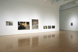 Extraits de la série «Marquer le territoire - transformer l'espace », photographies montées sur aluminium, dimensions variables, vue partielle de l'exposition «Territoires urbains », Musée d'art contemporain de Montréal, Montréal, 2005 (photo: R.-Max Tremblay)