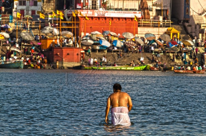 Pilgrim taking bath in Varanasi Ganges