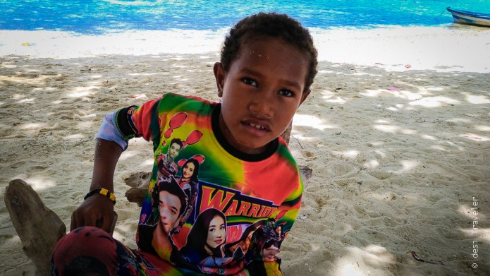 A kid wearing Bollywood shirt in Indonesia Arborek village