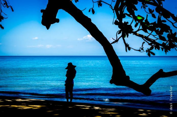 Girl in hat on beach silhouette Thailand