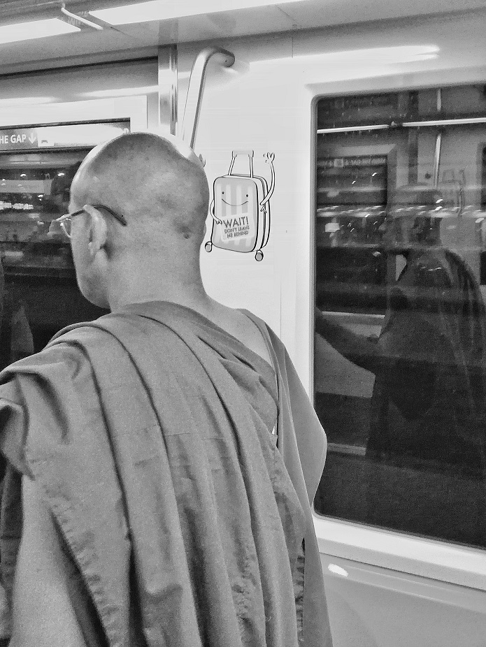 The Monk Who Took The Train at Changi Airport Singapore