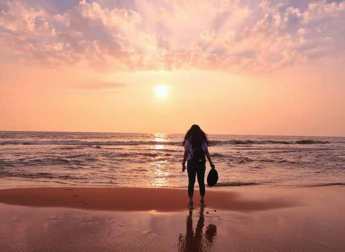 Girl watching Sunset Veli Beach Trivandrum