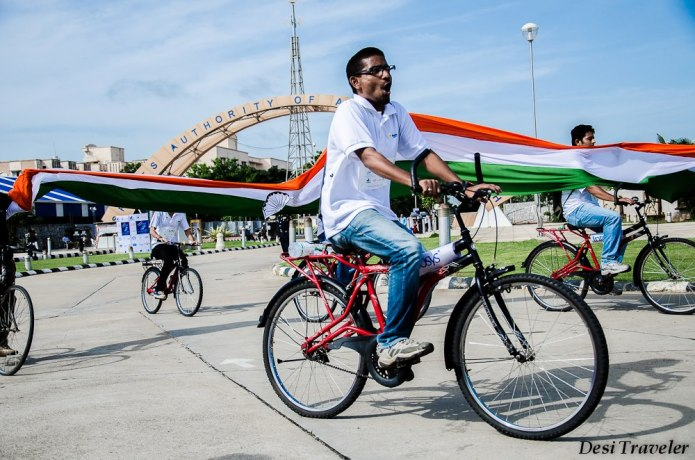 Cyclist carrying national flag of India