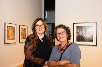 Exhibit attendee with Rosemary Strembicki at the Stan Strembicki & Alumni Art Show Opening Reception, Des Lee Gallery, St. Louis, MO