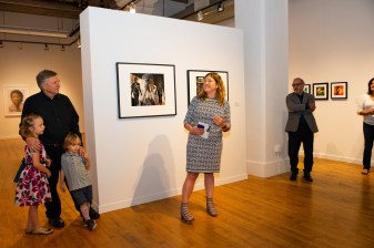 Curator Susan Moore honors Stan at the Stan Strembicki & Alumni Art Show Opening Reception, Des Lee Gallery, St. Louis, MO