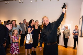 Stan takes a selfie in his iconic style at the Stan Strembicki & Alumni Art Show Opening Reception, Des Lee Gallery, St. Louis, MO