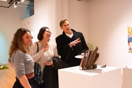 """Gallery Visitors talk with Sarah Knight about her piece """"Gorges of Your Exalted Body,"""" Parabola: Assembly exhibition, Des Lee Gallery, Washington University, St. Louis, MO"""