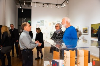 Rick Smith (left), son of Robert C. Smith, talks with retired SFS professor Sarah Birdsall and Sam Mitchell at the Robert C. Smith Retrospective Exhibit Opening, Des Lee Gallery, St. Louis, MO