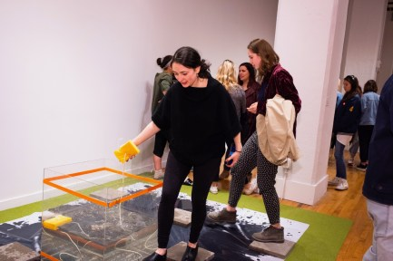 """From left, Juilet Roll and Georgina Halper interact with the installation """"30minutes"""" by Megan Jiyoung Lee at the BFA 2 Show on display at the Des Lee Gallery, Washington University, St. Louis, MO"""