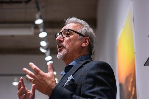 """Carmon Colangelo, Dean of the Sam Fox School of Design & Visual Arts, gives remarks at the Opening Reception of the """"Decoys and Depictions: Images of the Digital"""" Exhibition at the Des Lee Gallery, Washington University, St. Louis, MO"""