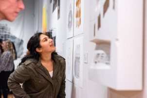 """Shameen Akhtar views the piece """"Color Space, 2017 by Yasmin Vobis, Ultramoderne"""" at the Opening Reception of the """"Decoys and Depictions: Images of the Digital"""" Exhibition at the Des Lee Gallery, Washington University, St. Louis, MO"""