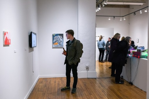"""Joe Whalen watches """"Sweet Jane (Live) at the Matrix, November 27, 1969"""" by Chris Scott on display at the Parabola: Extraterrestrial Exhibit, Des Lee Gallery, Washington University, St. Louis, MO"""