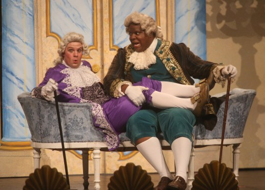 Still believing he is actually the prince, Dandini, played by Conor McDonald, is pressured by Don Magnifico, played by Joshua Conyers, to choose between his daughters. The Des Moines Metro Opera's OPERA Iowa educational program presented Rossini's Cinderella Feb. 28 at Indianola High School.