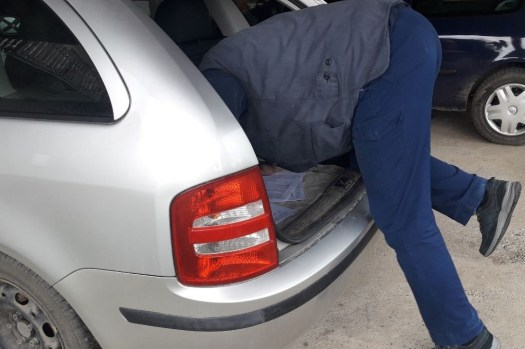 getting-inside-the-car-through-the-trunk