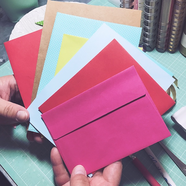 Make a simple, but oh-so-cute, corner bookmark out of junk-mail envelopes or your favorite patterned scrap book paper.