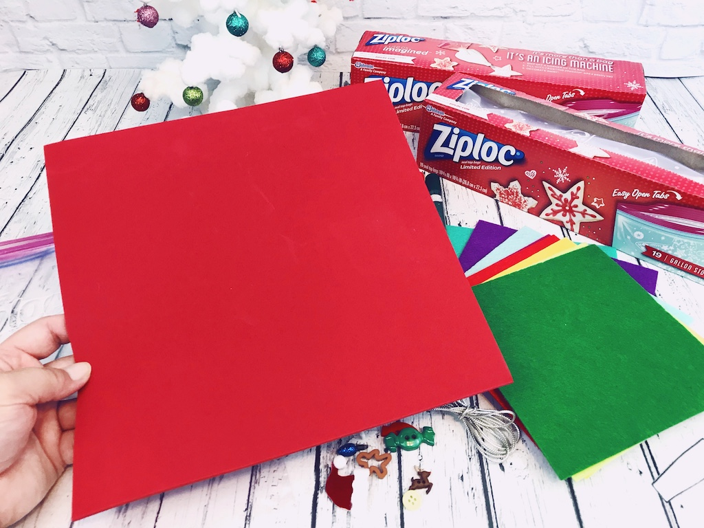 Sending holiday cheer is easy with Ziploc© seal top bags filled with ugly sweater craft kits and all the supplies to make holiday crafting fun!