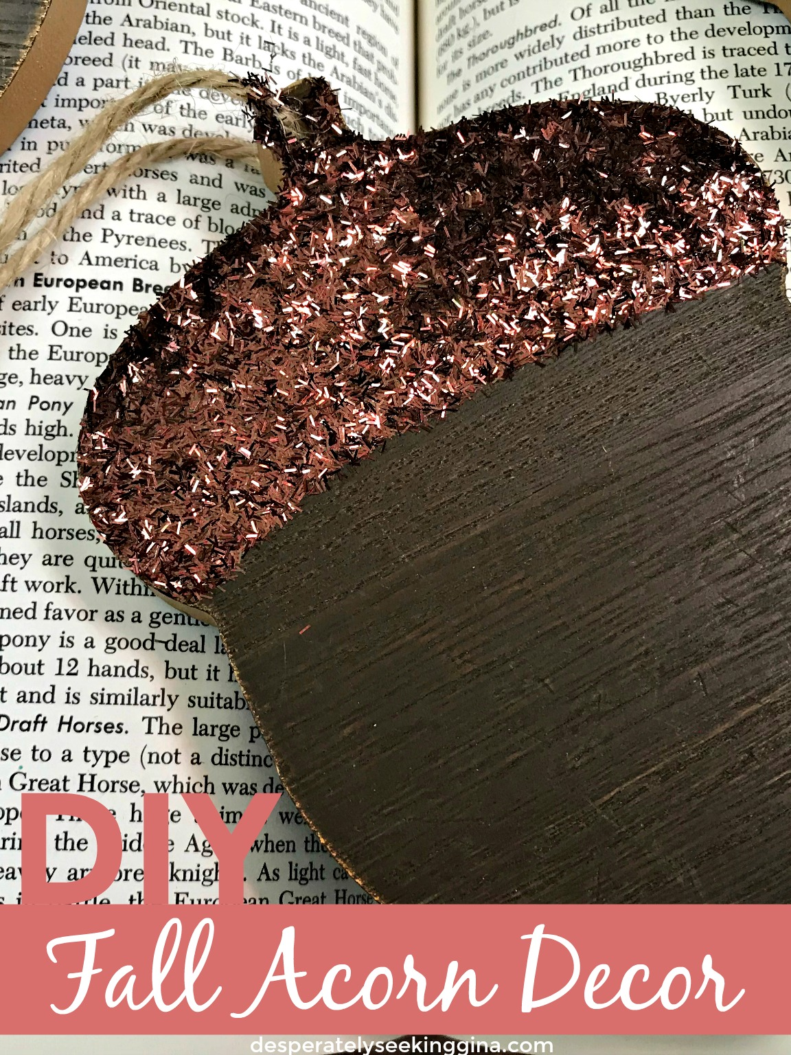 Wooden acorn ornament decorated with brown sparkly glitter via desperately seeking gina