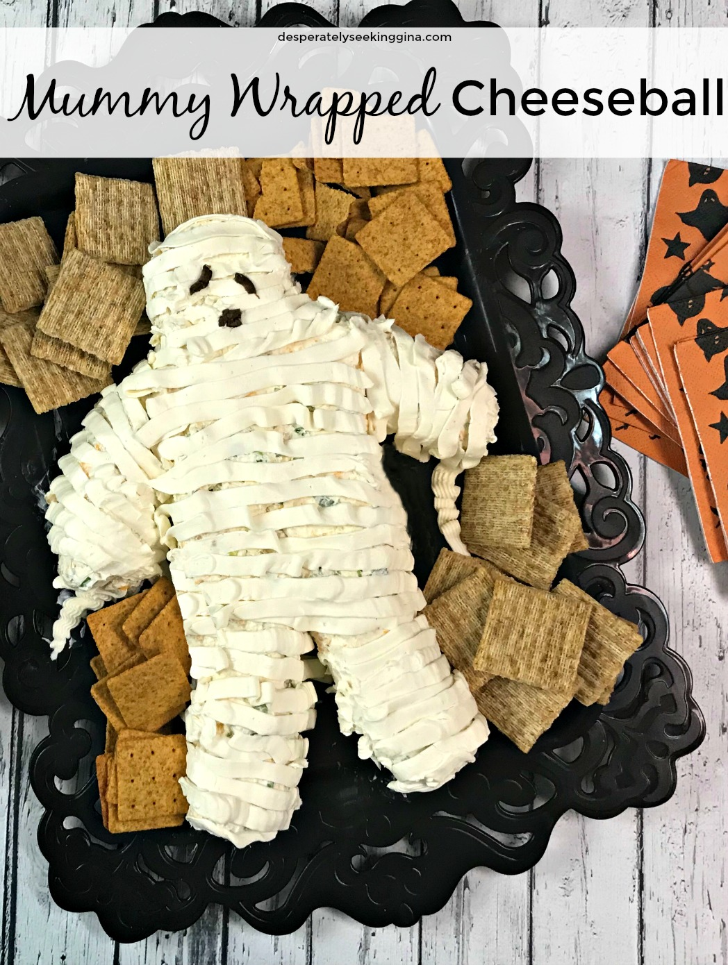 Delight your Halloween party guests with a delicious mummy wrapped cheeseball.