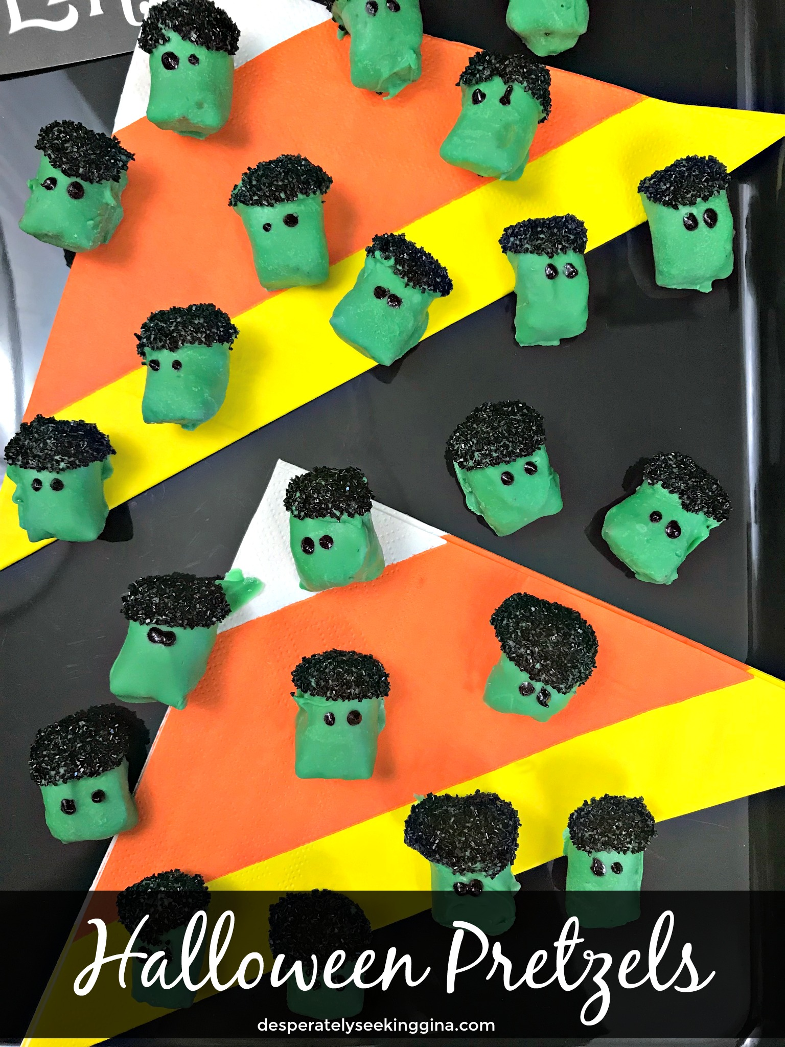 Fun Halloween Pretzels dipped in green candy coating and black sanding sugar for Frankenstein inspired Halloween candies.