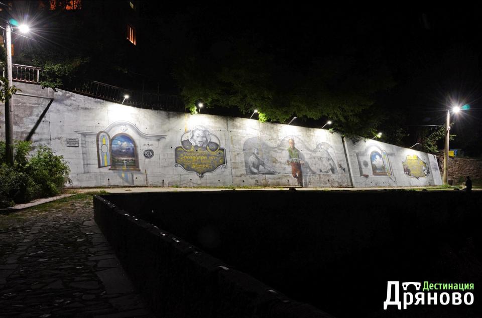 Стената на Колю Фичето - нощем 1, лого