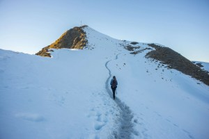 hiking to the summit of roys peak in the snow