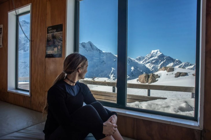 looking at the view from inside of the mueller hut