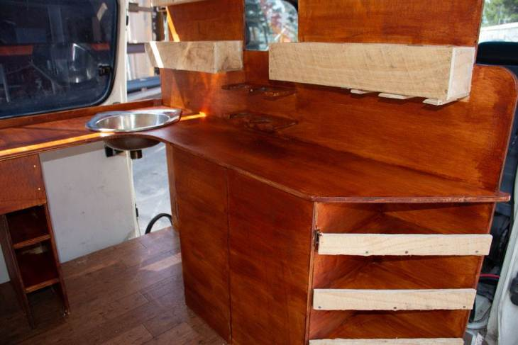 staining the kitchen in our van conversion