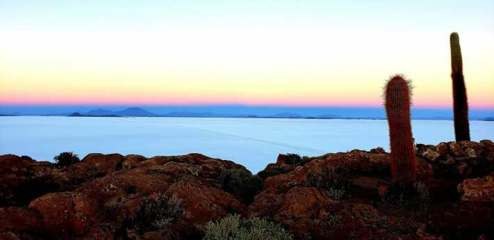 A blue, yellow and pink sky during the sunrise at the uyuni salt flats