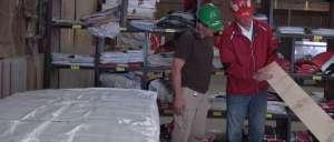 Matt and fellow employee inspecting a board.