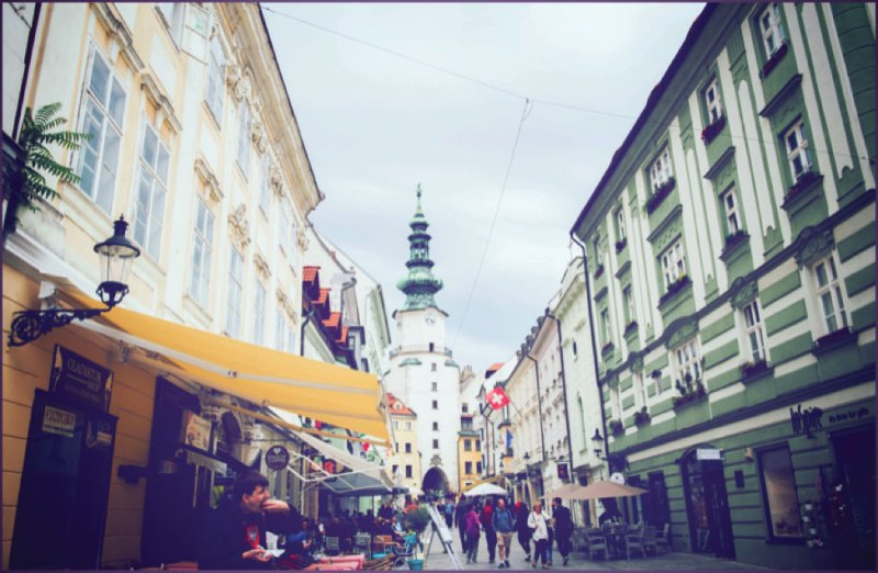 The charming streets of Bratislava with Michael's Gate standing tall at the back
