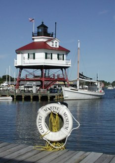 Drum Point Lighthouse dominates the Calvert Marine Museum's waterfront. This screwpile, cottage-type light is only one of three remaining from 45 that once served the Chesapeake Bay at the beginning of the 20th century.