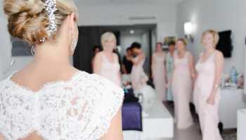 Beach wedding hair expert tips photos destination wedding details beach wedding hair styles junglespirit Image collections
