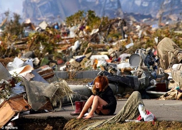 Girl-devastated-after-the-tsunami-that-hit-Japan-in-2011