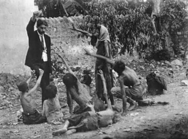 Turkish-official-teases-starving-Armenian-children-by-showing-them-a-piece-of-bread-during-the-Armenian-Genocide-in-1915