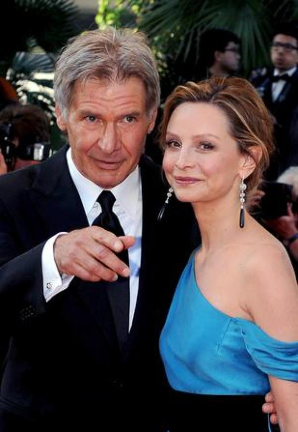 epa01349452 US actors Harrison Ford and Calista Flockhart arrive for the gala screening of US director Steven Spielberg's film 'Indiana Jones 4' running out of competition at the 61st edition of the Cannes Film Festival, 18 May 2008, in Cannes, France.  EPA/CHRISTOPHE KARABA