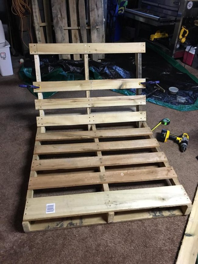 Then it was time to put it back together! He made sure to measure and space each board evenly apart.