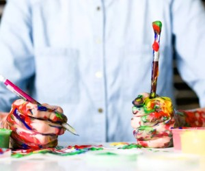 guy with hands covered in paint