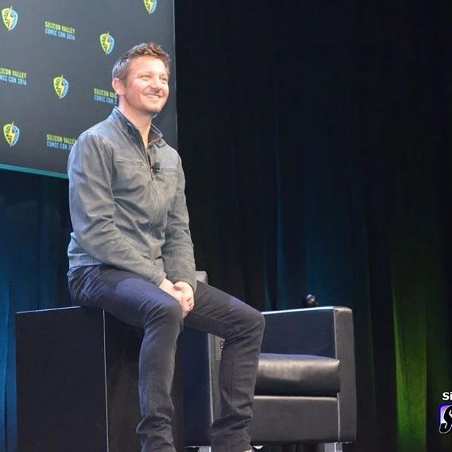 jeremy renner onstage at a panel at svcc 2016