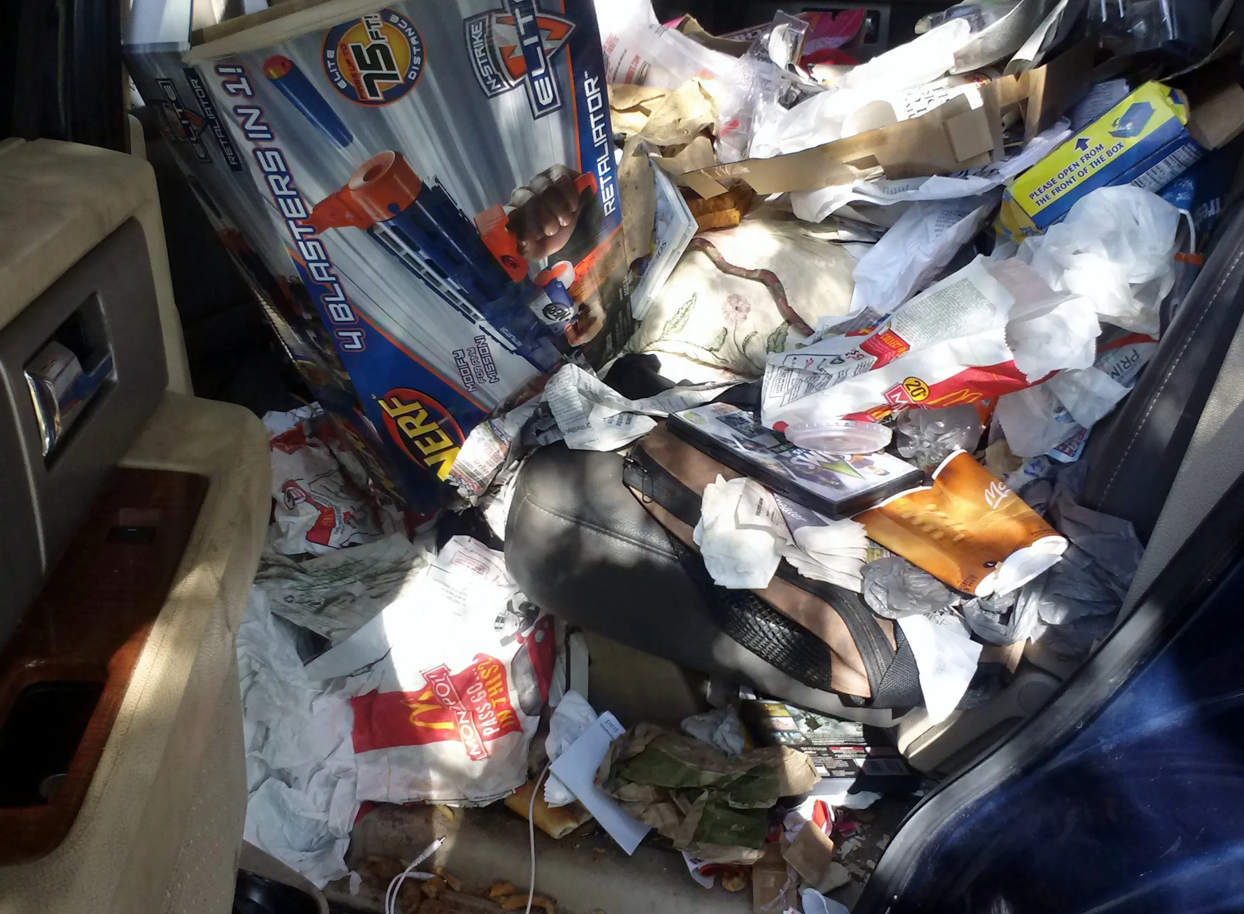This Car Interior In Clearwater Needs Detailing And Serious Trash Removal