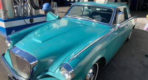 Shiny teal vintage car after cleaning at Rainbow Carwash Detail Plus in Sunnyvale, California