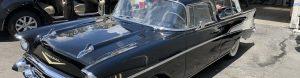 Sleek black vintage car parked at Detail Plus Rainbow Carwash