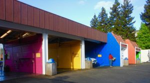 Colorful rainbow carwash bays at Rainbow Carwash Detail Plus