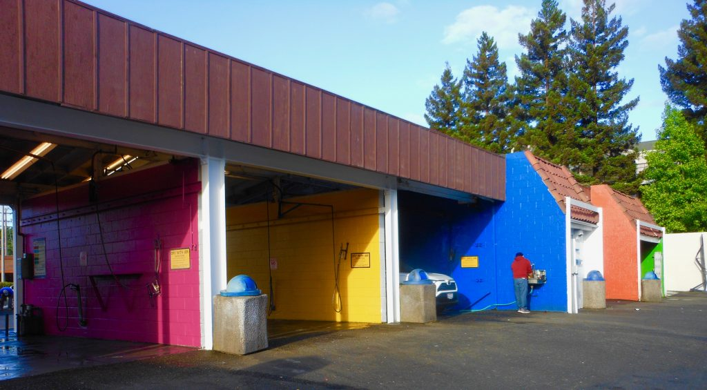 Colorful rainbow carwash bays at Rainbow Carwash Detail Plus