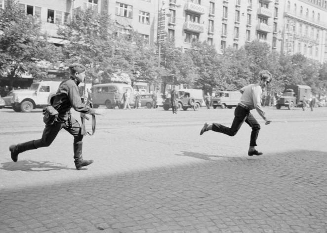 The Prague Spring of 1968: Soviet soldier chasing young man who had thrown stones at a tank