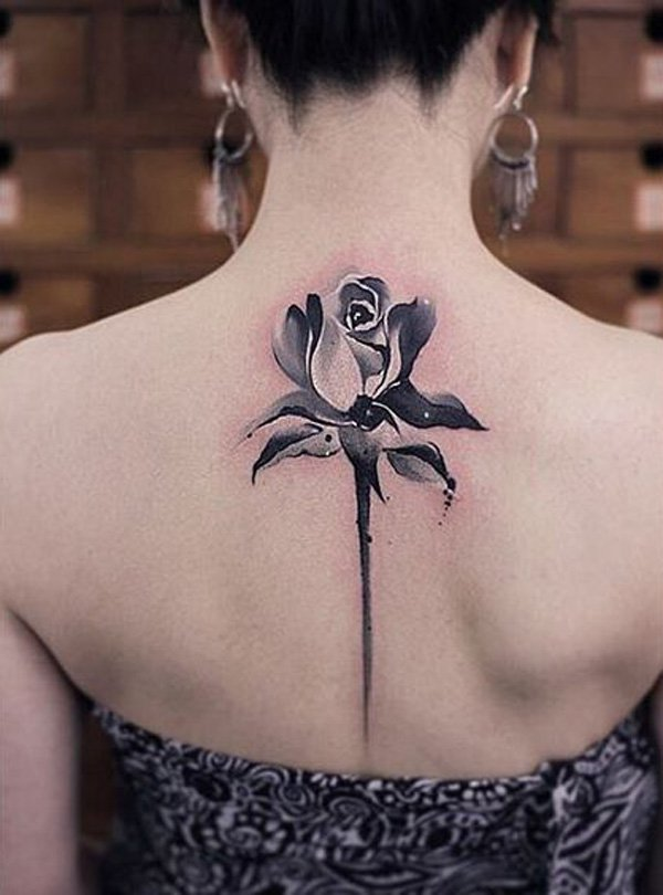 Another rose spin tattoo but this one is much subtler and smaller.