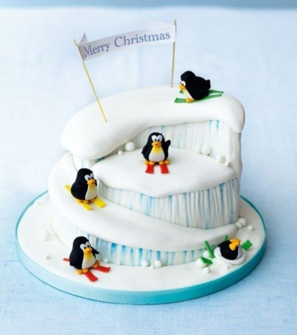 a really cute and comical christmas cake the cake is filled with cute little penguins - Christmas Cake Decoration Ideas