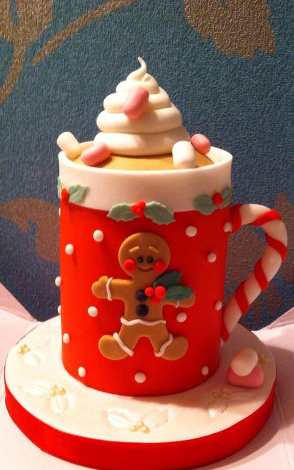 Beautiful mug themed Christmas cake. The design on the mug is also inspired by the gingerbread man who is also a popular figure during Christmas season.