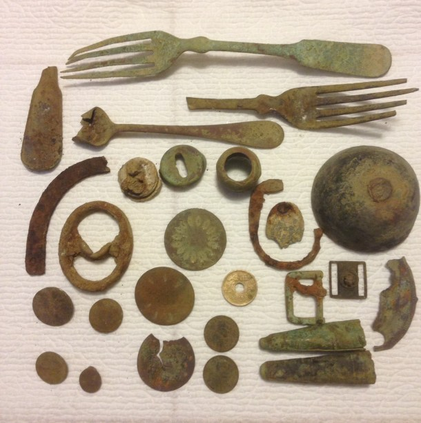 My BONE FINDS: forks, buttons, a bell, ox knob, and your guess is as good as mine on the rest...